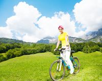 Young woman on a bike Stock Photo