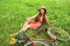 Young woman and bike Royalty Free Stock Image