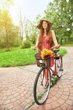 Young woman and bike Royalty Free Stock Photos