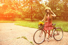 Young woman and bike Stock Photo