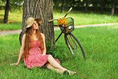 Young woman and bike Royalty Free Stock Photo