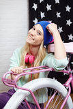 Young woman with bike at home Royalty Free Stock Images