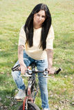Young woman on bike outdoors. Young woman on bike relaxing outdoors Stock Photos