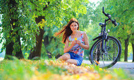 Young woman with a bike Royalty Free Stock Photography