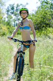 Young woman on a bike ride. Stock Photos
