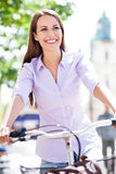 Young woman on bike Stock Image