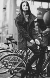 Young woman with bike Stock Photography