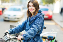 Young woman on bike. Smiling Royalty Free Stock Photos