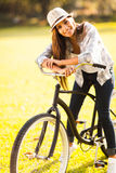 Young woman bike Royalty Free Stock Image