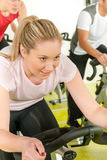 Young woman at bike spinning class Royalty Free Stock Images