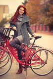Young woman with bike Stock Photo
