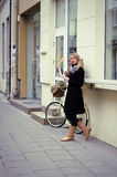 Young woman and bike in street Royalty Free Stock Image