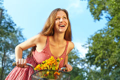 Young woman and bike Royalty Free Stock Images