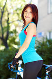 Young woman and bike Royalty Free Stock Photography