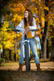 Young woman biking Stock Photo