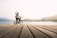 Young woman biking. Stock Photo