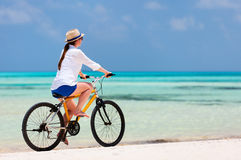 Young woman biking Royalty Free Stock Photos