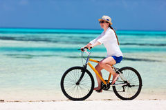 Young woman biking Stock Photography