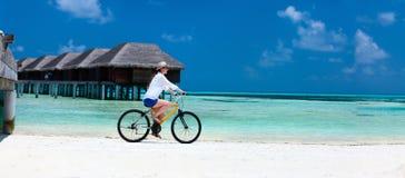 Young woman biking Royalty Free Stock Image