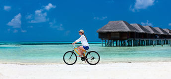 Young woman biking Stock Images