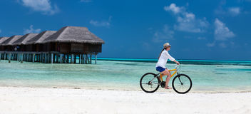 Young woman biking Stock Image