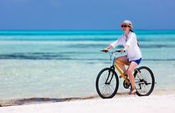 Young woman biking Royalty Free Stock Photography