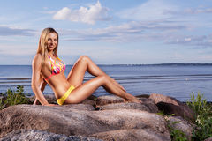 Young woman in bikini on beach Royalty Free Stock Photography