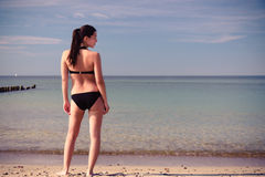 Young woman in a bikini on the beach Royalty Free Stock Image