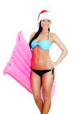 Young woman in bikini and christmas hat Royalty Free Stock Photos