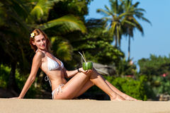 Young woman in bikini with cocktail Stock Image