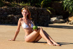 Young woman in bikini with cocktail Stock Photo