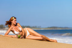 Young woman in bikini with cocktail Royalty Free Stock Photos