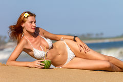 Young woman in bikini with cocktail Stock Images