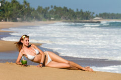 Young woman in bikini with cocktail Royalty Free Stock Photography