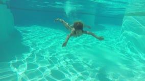 Woman swimming underwater stock video footage