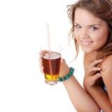 Young woman in bikini drinking ice tea Stock Photography