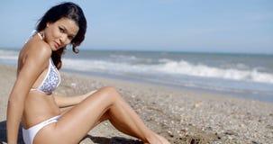 Young woman in a bikini enjoying a day at the sea stock footage