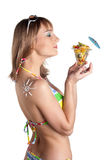 Young woman in bikini with fruit salad Royalty Free Stock Photography