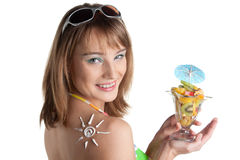 Young woman in bikini with fruit salad Royalty Free Stock Photo