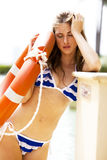 Young Woman in a Bikini Holding a Life Preserver Royalty Free Stock Photos
