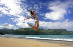 Young woman in bikini jumping at Rincon beach, Samana peninsula. Dominican Republic stock images