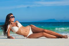 Woman laying by sea Royalty Free Stock Images
