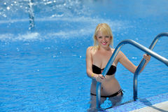 Young woman in a bikini at the pool Stock Image