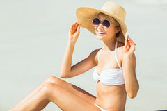 Young woman in bikini posing with hat Stock Photos