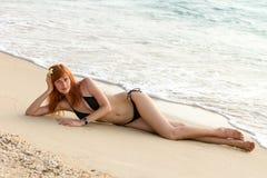 Young woman in bikini posing on sea coast Stock Photo