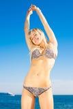Young woman in bikini on seashore Royalty Free Stock Photo