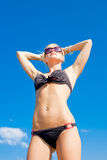Young woman in bikini on seashore Stock Image
