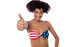 Young woman in bikini showing thumb up Royalty Free Stock Image