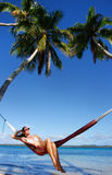 Young woman in bikini sitting in a hammock Royalty Free Stock Photos