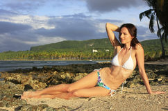 Young woman in bikini sitting at Las Galeras beach, Samana penin Royalty Free Stock Image